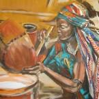 Frau im Tschad beim Buttern